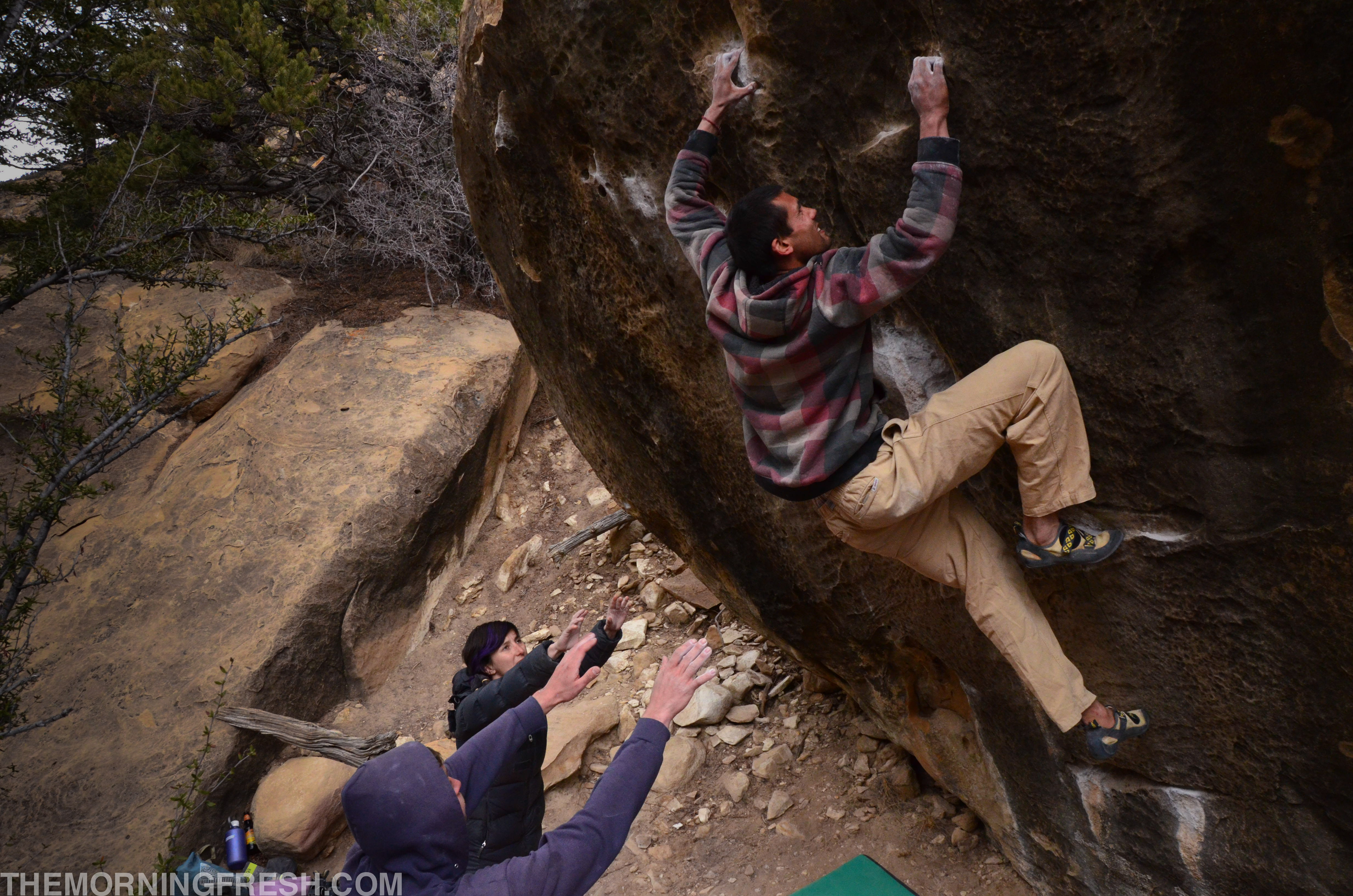 Spenser climbing Save Yourself (V9) in Joe's Valley.