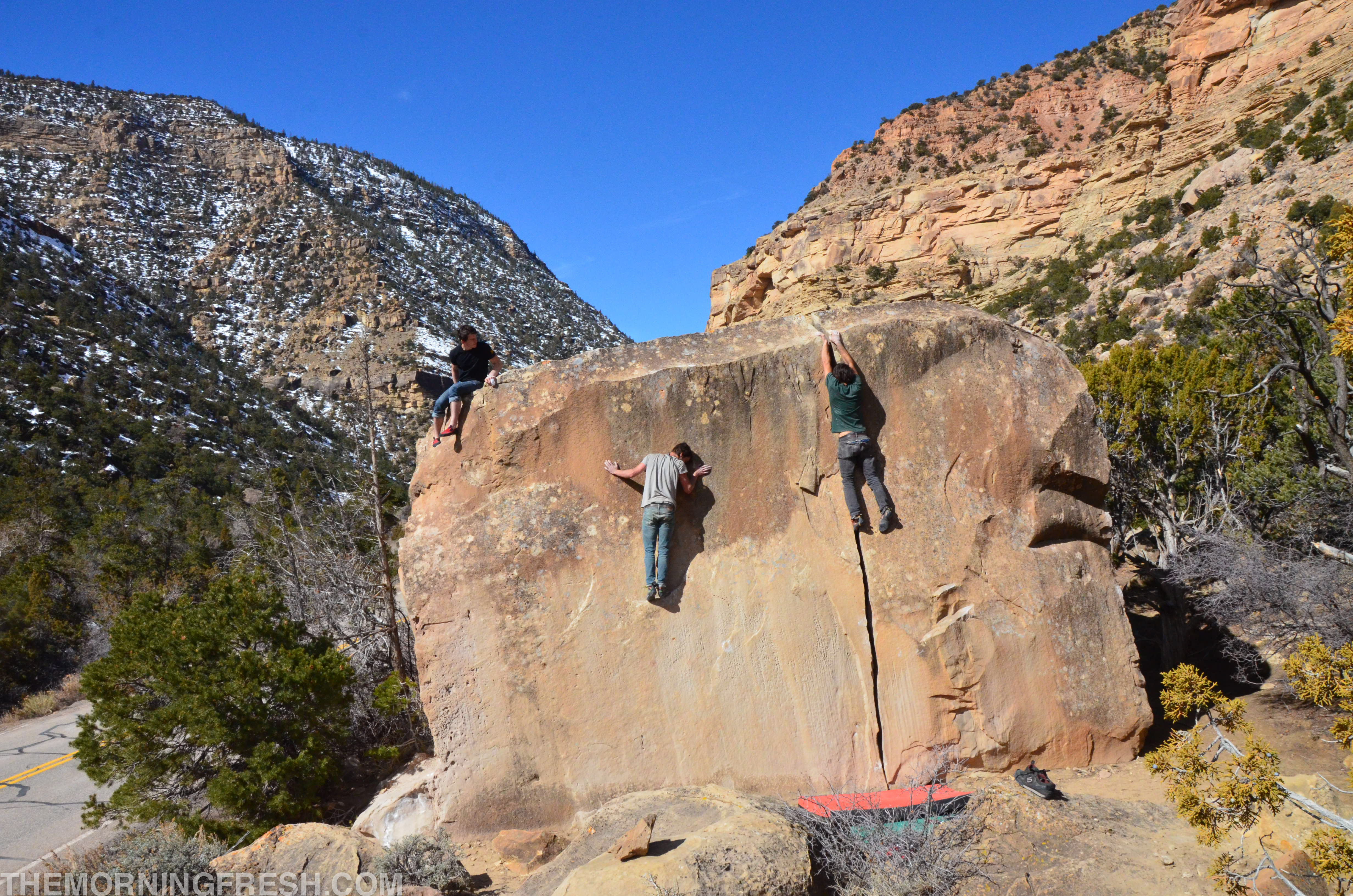 Niko, Bo, and Cox messing around on the landmark crack boulder in the Left Fork of Joe's Valley in Utah.