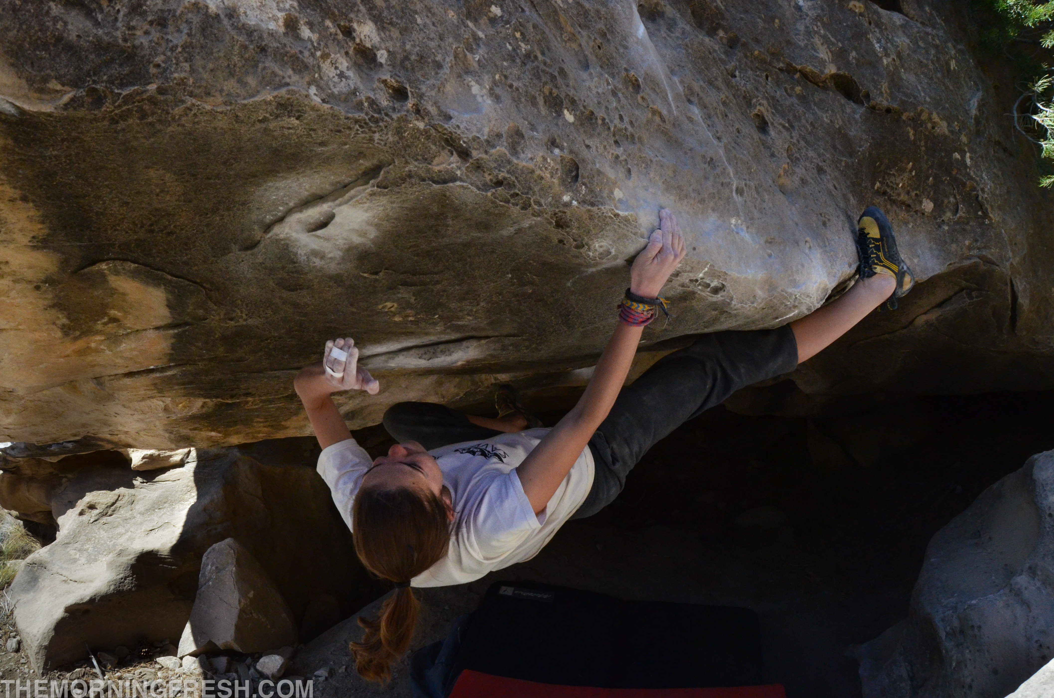 Gunning for the perfectly placed crimps on Kill By Numbers (V5) in Joe's Valley, Utah.