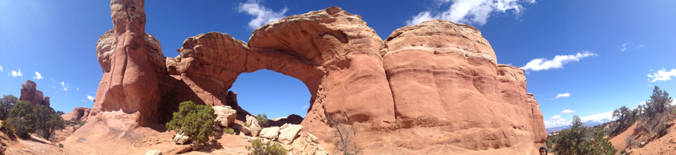 Broken Arch looms from high above Arches National Park in Moab.
