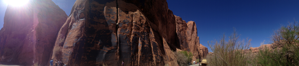 Niko climbs a mega crack at Wall Street on Potash Road in Moab.