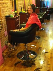 Check out all my long hair - discarded on the floor at Crops For Girls Salon in NYC!