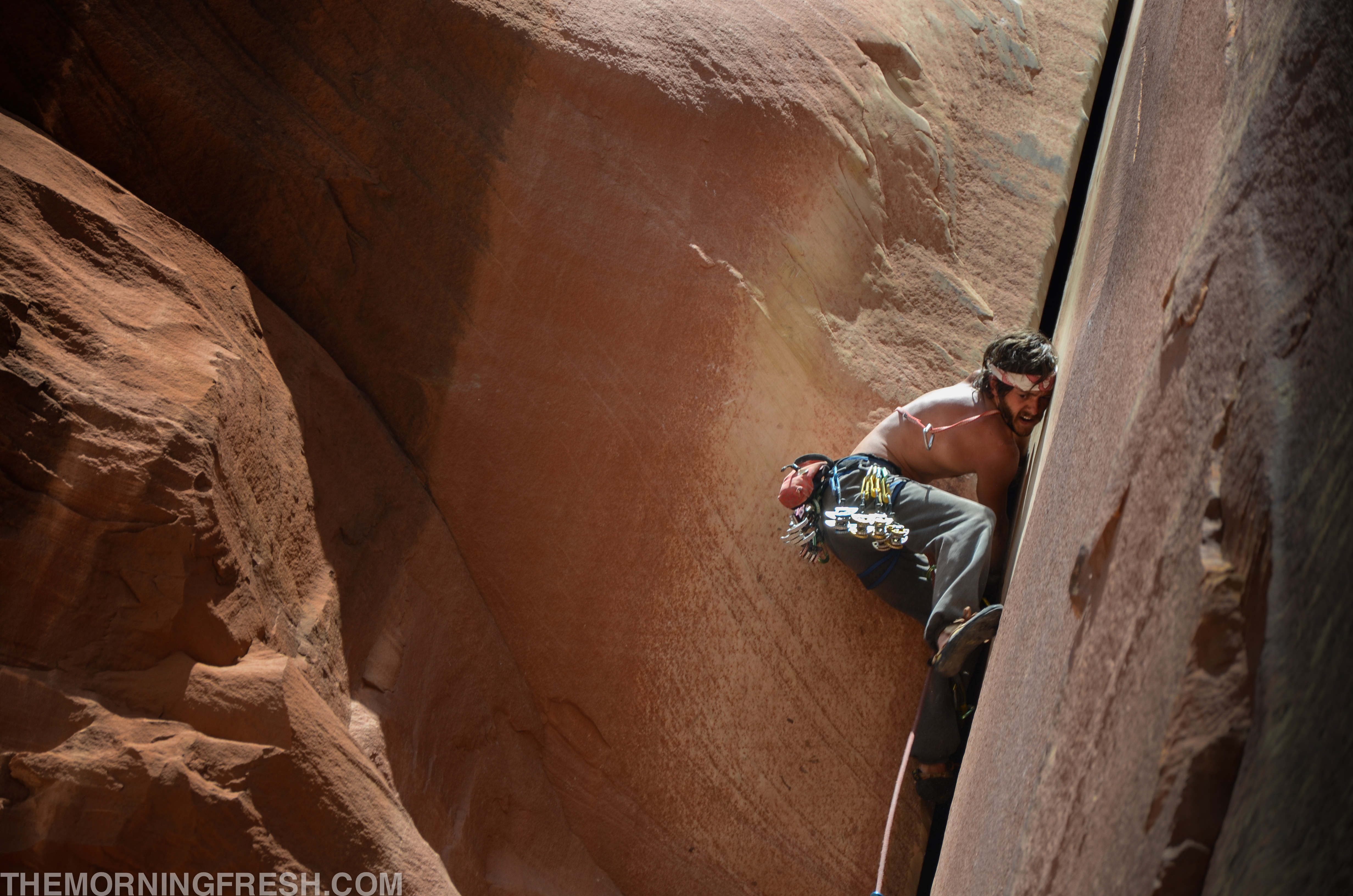 Jeremy Rush using everything he has on Incredible Hand Crack (5.10c) at Indian Creek in Utah.