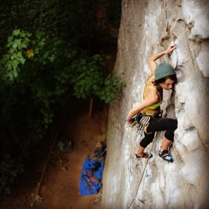 Climbing at Red River Gorge with my Yellow 108 Travis Beanie.