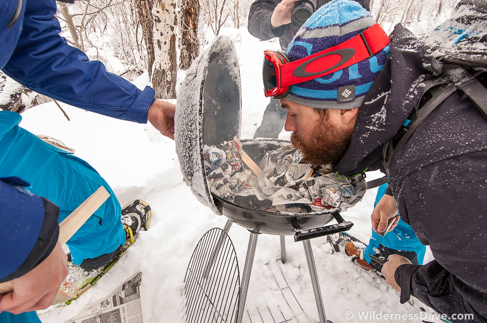 Seth from #TeamBeard stokes a fire during the hot cocoa challenge at the Omnigames.