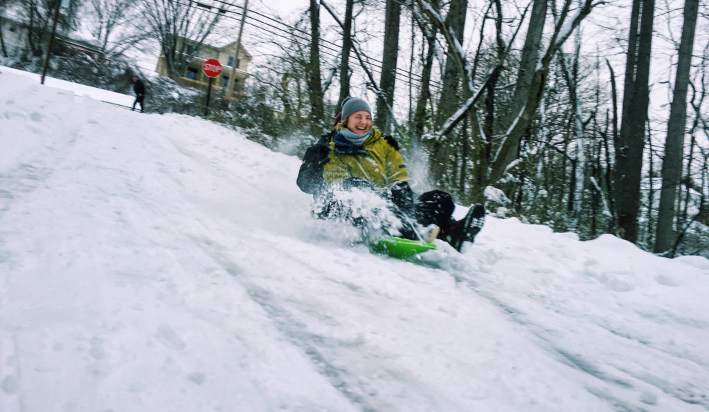 Sledding during the big 2016 Asheville snowstorm.