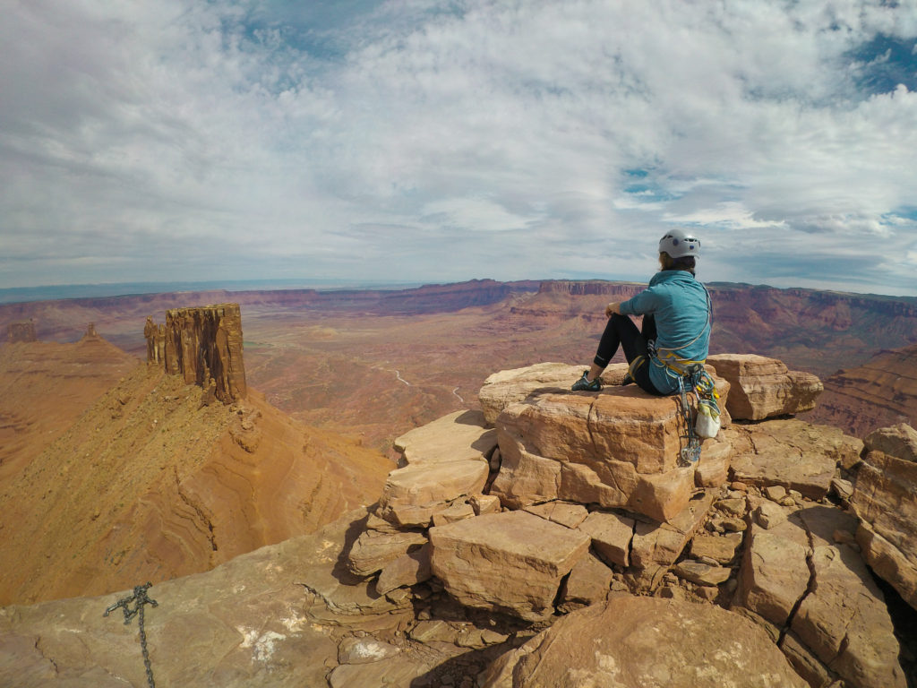 Enjoying a peaceful moment at the top of Castleton Tower in Moab, UT.
